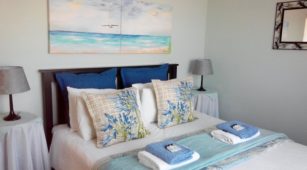 Chalet - Main Bedroom with Queen Bed and Sea View! Painting by owner is for sale.